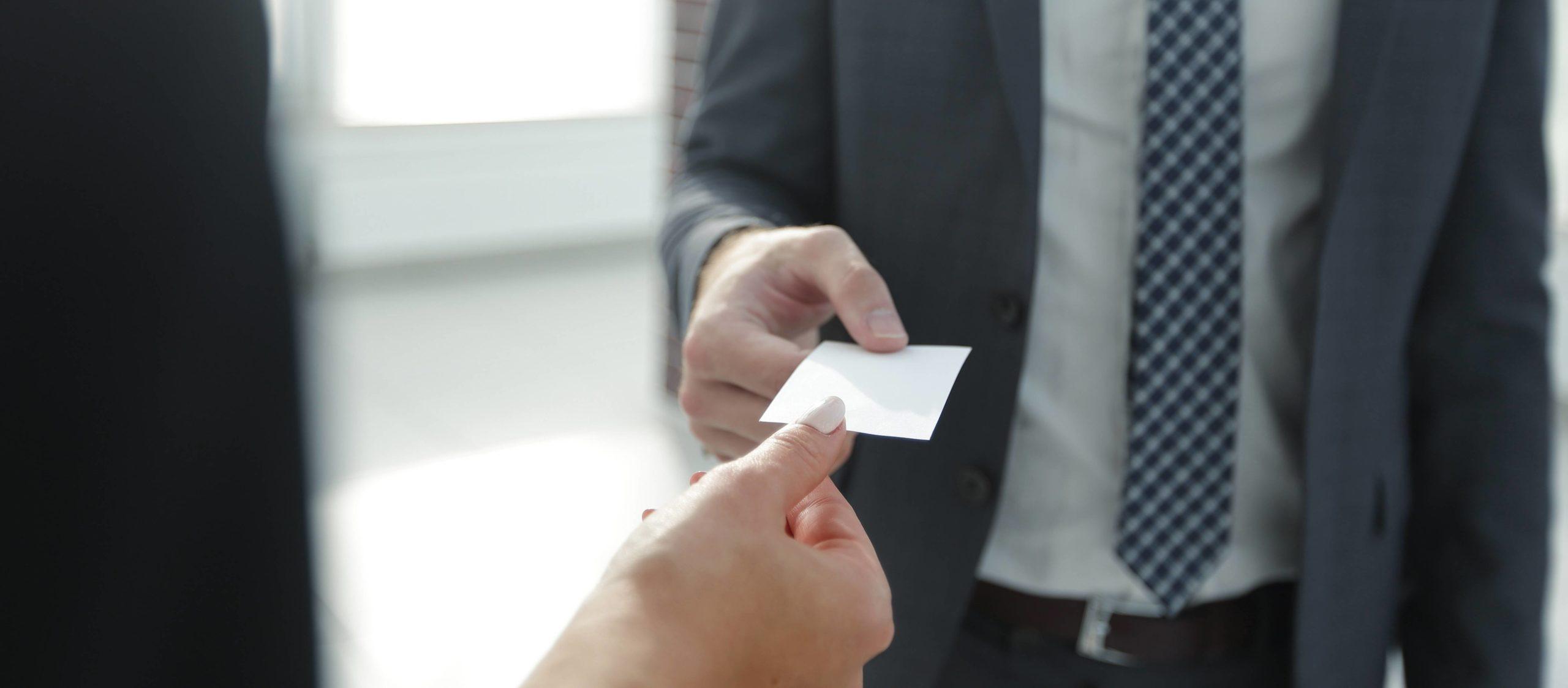 Businessman giving visit card